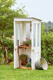 make a mini potting shed from old doors this project is from the book