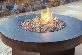 patio round fire pit table with colorful glass beads and the flame regard to plan 16