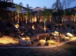 small pond like pool in natural landscape with attractive landscape lighting ideas on the ground