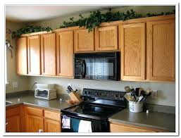 top of kitchen cabinets decorating ideas tips for kitchen counters decor home and cabinet reviews top of kitchen cabinet decorating ideas
