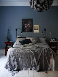 bedding for black furniture. dark and moody bedroom with navy blue painted walls gray bedding a mix for black furniture n