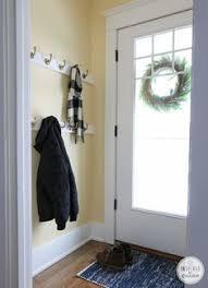 Front Door Coat Rack Make multi layer coat rack behind the front door School organizer 1