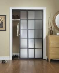 frosted glass sliding closet door options with wooden chest drawer under round mirror and framed painting