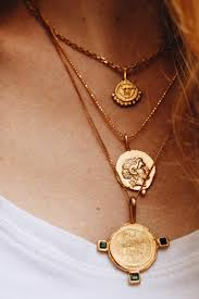 we re totally coveting coin necklaces