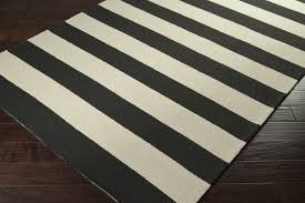 black and cream striped rug