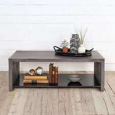 In., making it a perfect fit in smaller living rooms, and its neutral gray finish will look great with your color scheme. Industrial Concrete Coffee Table