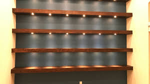 build wall to wall shelves with recessed lights