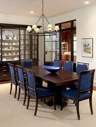 stunning traditional dining room design with darkwood coffee table and blue upholstered dining chairs country home