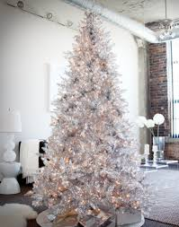 White Winter Christmas Decoration Featuring Lighted Silver Christmas Tree.