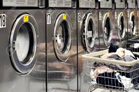 row of washing machines. Brilliant Row Row Of Industrial Washing Machines In A Public Laundromat With Laundry  Basket Stock To Of Washing Machines R