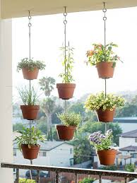 Hanging rows of simple terra-cotta pots from above to form a vertical  garden that doubles as a screen. You'll also gain valuable real estate by  lifting your ...