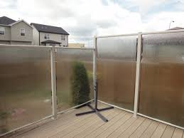 deckview glass and railing framed privacy with rain glass