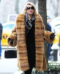 feeling fabulous joan looked like she was having a ball as she showcased her style