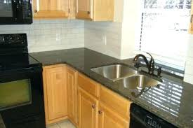 backsplash ideas for black granite countertopaple cabinets ideas for black granite white ceramic tile