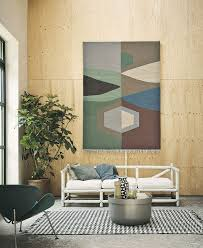 how to nail the hanging rug trend