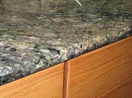 we install tile countertops this granite countertop we customized with a laminated tile and bullnosed edge to give it that slab appeal without the slab