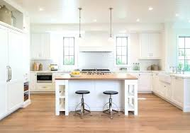 kitchen with a sink facing window and butcher block plus l shaped floating shelf shelves furniture