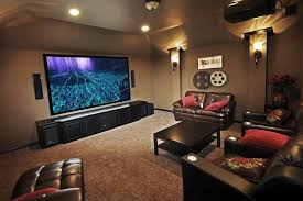 budget home theater room. rather than buying a separate rack for just a/v equipment and then having to route all the wiring from wet bar area. budget home theater room s