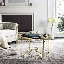 Today i'm sharing coffee table styling ideas with black white gold and silver home decor. Amazon Com Safavieh Home Collection Elisha Black And Gold Leaf Round Coffee Table Furniture Decor