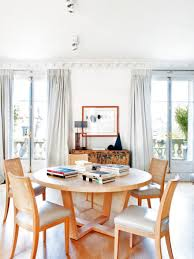 dining with eiffel tower view. 8-2-paris-apartment-interior-design-contemporary-style- dining with eiffel tower view y