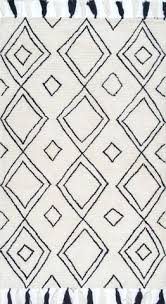 black and white diamond rug. ekati diamond tassel rug in white and black