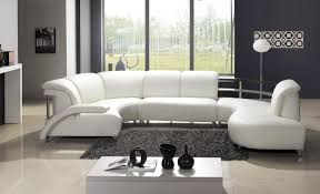 affordable modern furniture with black carpet and white sofa and floor and white table white lamp and black wall