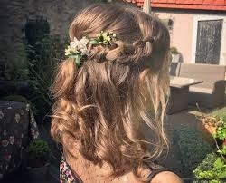 down prom hairstyles close up shot of a woman with bronde hair styled into a