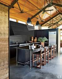 lake flato designed the kitchen s cabinetry steel hood and island the range and refrigerator are by viking