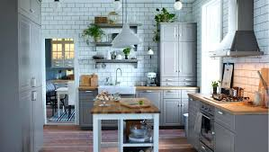 shaker cabinets kitchen white tile wall light gray cabinets kitchen island wood floors white ceramic shaker