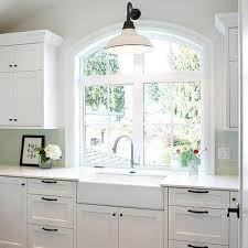 white and green laundry room with green subway tiles