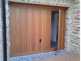 there have been garage doors for many years with a wicket or p door inset into the main panel on the market for a while but more recently the demand