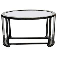 art deco bauhaus style cocktail or occasional table in black lacquer and glass for