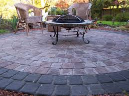 paver patio ideas with concreate also rattan chairs and table also fireplace