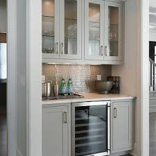 living room bar with gray cabinets and glass front wine fridge
