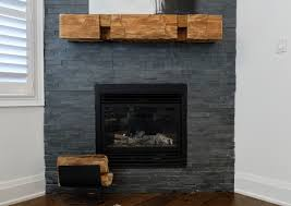 charcoal gray tile provides contrast for this unique mantel a 200 year old beam from the home ing ing season 7 episode 10