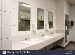public bathroom mirror. Brilliant Bathroom Perspective Shot Of A Counter Top With Three Sinks And Mirrors In Stark  Public School Bathroom In Public Bathroom Mirror