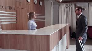 pan shot of business hotel lobby guest at the reception desk talking to clerk stock footage 6854323 shutterstock