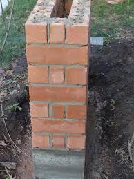 Case Study: Brick Pillar, Soldier's Course, Custom Concrete Cap, Wrought  Iron Metal