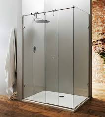 a bespoke frameless sliding shower door with fixed side panel made with 10mm thick toughened safety