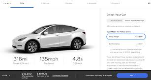 Tesla made a surprise announcement of the tesla bot,. Tesla Lowers The Starting Price Of Its Model Y Electric Suv Techcrunch