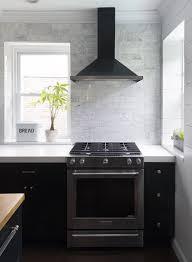 black range hood. Plain Hood Black Kitchen With Full Wall Of White Marble Tile Black Range Hood  Stainless Stove Dessign Manifest To Range Hood