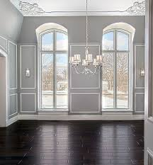 wainscoting dining room. The Floor To Ceiling Windows Allow An Abundance Of Light Into Dining Room, Which Illuminates Bright White Wainscoting That A Encompasses Room. Room E