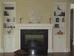 interior white mantel shelf fireplace with black metal firebox added by double white wooden shelf