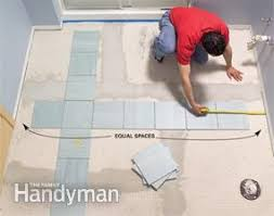 Photo 9: Test your layout to avoid small pieces along the walls. Dry-lay  tile ...