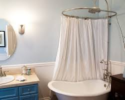 clawfoot tub and shower combo. inspiration for an eclectic claw-foot bathtub remodel in san francisco with blue cabinets and clawfoot tub shower combo