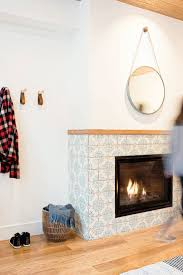 best 25 tiled fireplace ideas on fireplace tile surround fireplace warehouse and subway tile fireplace