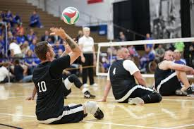 u s department of defense photo essay  retired army sgt matthew spang serves the ball while playing sitting volleyball against the air