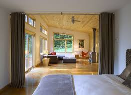 view in gallery curtains offer a simple and effective way to separate the bedroom from the living area