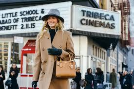 natasha poly streetstyle new york fashion week camel coat winter trends
