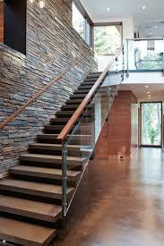 Glass Stair Railing With Stone Wall